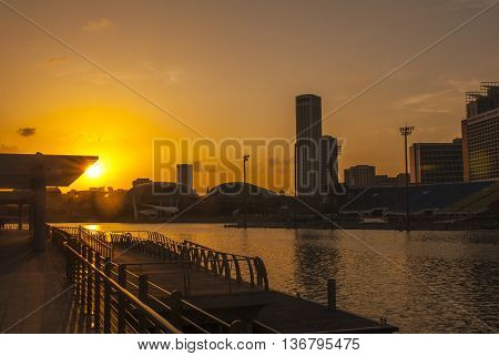 Water front sunset of Singapore skyline a modern urban city
