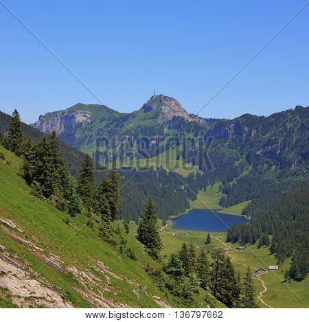 Summer scene in Appenzell Canton. Travel destination Mt Hoher Kasten and Samtisersee.