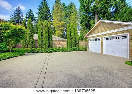 Double Doors Garage With Wide, Long Driveway. North America.