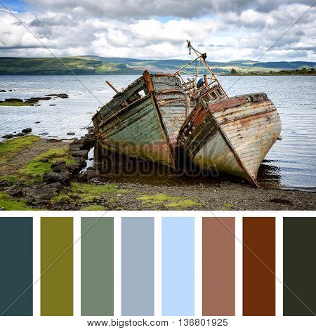 Two abandoned fishing boats in Salen Sound, Isle of Mull, Inner Hebrides, Scotland. In a colour palette with complimentary colour swatches.