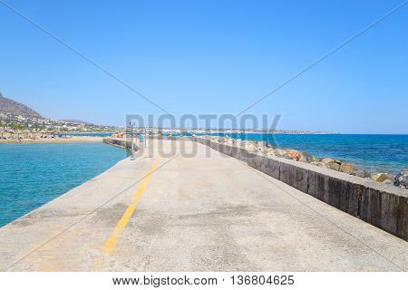 Pier on the coast of Cretan Sea near Hersonissos Crete Greece.
