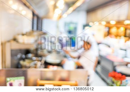 Blurred Background : Groups Of Chef Cooking In The Open Kitchen,customer Can See They Cooking At Foo