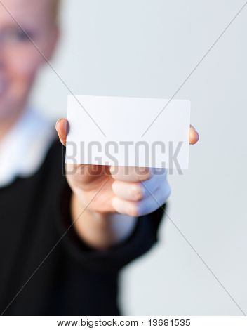 Young smiling Business woman holding out a business card