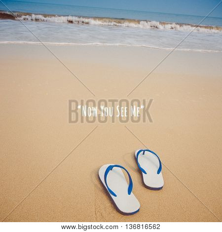 Inspirational quote poster by unknown source white sandals with blue stripe left on beachside.