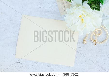 White blooming peony flowers vintage flat lay scane