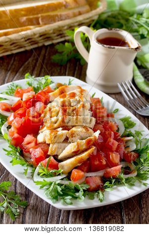 Salad Of Grilled Chicken With Leafy Vegetables, Watercress Salad, Tomatoes, Onions And Tomato Sauce.