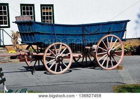Lancaster Pennsylvania - October 18 2015: Wooden Amish farm wagon with large wheels at the Amish Farm and House Museum