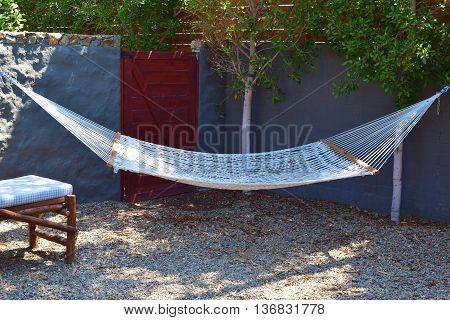 Hammock for relaxing taken in a residential backyard garden