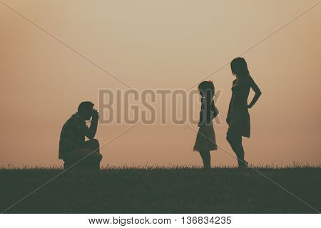 Man photographing his wife and  daughter outdoor.