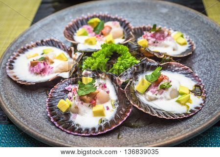 Highly detailed image of fresh scallops peruvian style