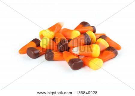 Halloween candy corns isolated on white, close up