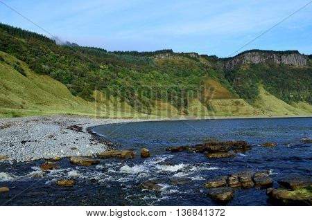 Beautiful veiw of Bearreraig Bay in Scotland the sea cliffs looming above the bay.