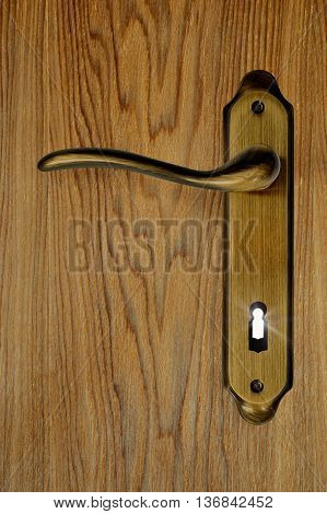entrance door and keyhole with light coming from it