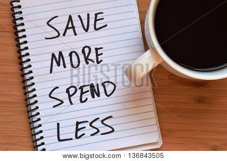 saving money concept written on a notebook