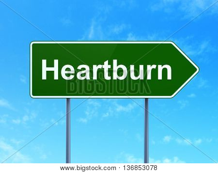 Health concept: Heartburn on green road highway sign, clear blue sky background, 3D rendering