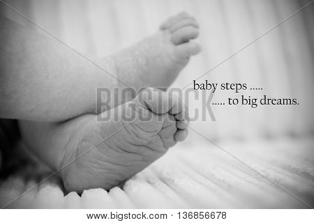 Baby feet on a settee with inspiring words