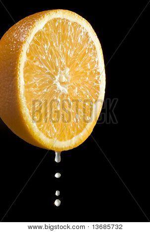 Orange Citrus Fruit With Juice Drops
