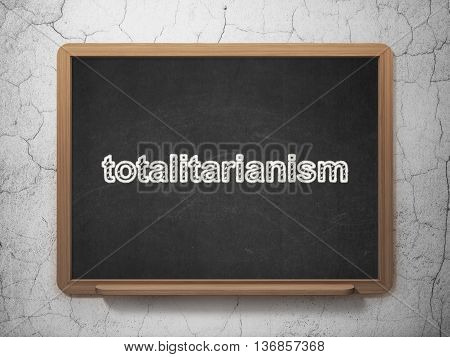 Political concept: text Totalitarianism on Black chalkboard on grunge wall background, 3D rendering