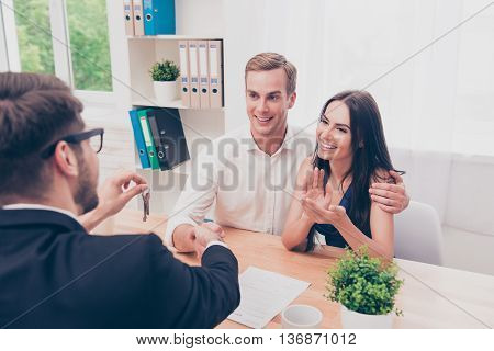 Portrait Of Happy Family Reach Agreement With Real Estate Agent