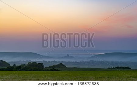 Rainbow skies in the Dorset Purbeck Hills above Corfe Castle