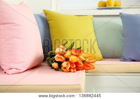 Bouquet of tulips on nook furniture