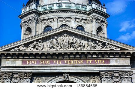 Facade Mary Jesus Statues Saint Stephens Cathedral Budapest Hungary. Latin Statement from Bible I am the Way the Truth and the Light. Cathedral built in the 1800s and consecrated in 1905.
