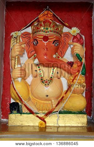 Idol of Ganesha decorated with painting at City Palace Udaipur Rajasthan India Asia