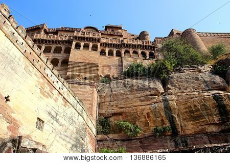 View from bottom of mammoth Meharongarh Fort situated on rocky hill in Jodhpur Rajasthan India Asia