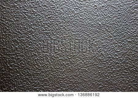 Sandy grain structure of grey painted cement wall