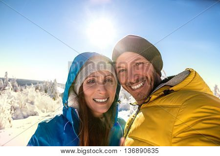 smiling wintersport selfie in the mountains