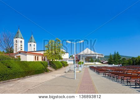 MEDJUGORJE, BOSNIA AND HERZEGOVINA - JULY 20, 2014: Saint James church of Medjugorje in Bosnia Herzegovina. Medjugorje since 1981, it has become a popular site of religious pilgrimage due to reports of apparitions of the Virgin Mary to six local Catholics
