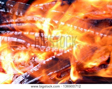 The coals in the fire and dancing flames