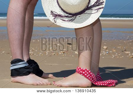 Attractive Couple At The Sea With Bikini Down And Hat