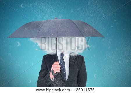 Unsmiling businessman sheltering under umbrella against blue vignette background