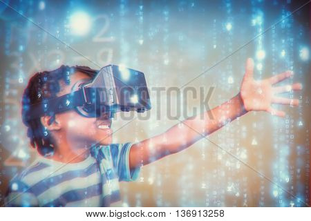 Smartphone apps icons against school boy in virtual reality glasses in classroom