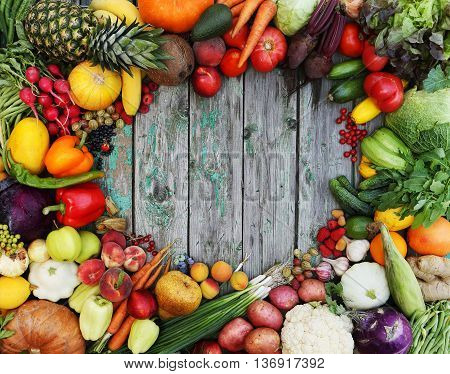 Healthy food background. Studio photo of different fruits on wooden table.