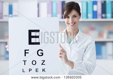 Professional Oculist Holding An Eye Chart