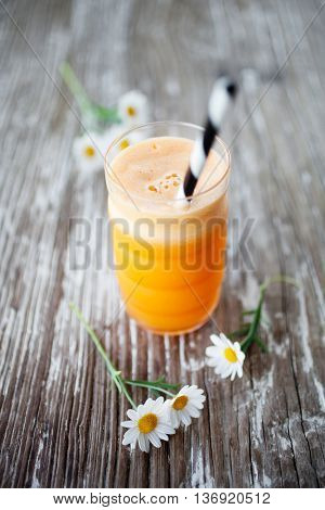 Fresh juice with carrot, apple, gingr and orange