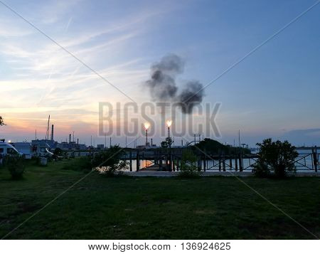Oil Refinery Bursting Flames At Sunset Close To Camping Site, Venice Italy