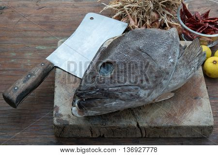 Grouper head on wooden cutting boards for Spicy fish head