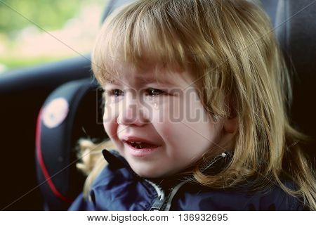 Small Boy Crying In Car