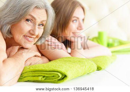 Portrait of a beautiful women getting spa treatment. Massage