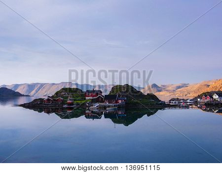 Lofoten Islands mirroring of reflecting red houses in water