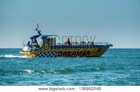 ALGARVE COAST PORTUGAL - MAY 19: A view of a outlook boat with people on the board near the coast Algarve in Portugal 2016