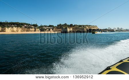 A view of the outlook boat from another sailing boat on the sea near the Algarve coast in Portugal 2016