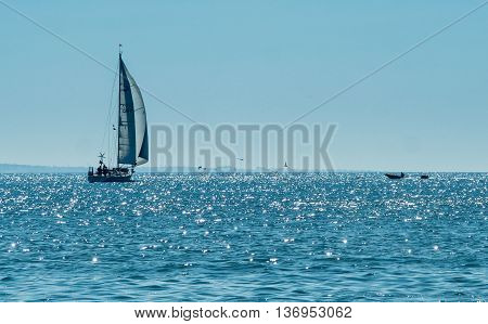 A view of the sailing boat near the Algarve coast in Portugal 2016