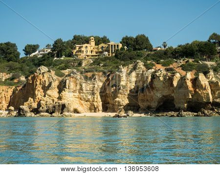 A view of houses on the Algarve coast from boat on the sea in Portugal 2016