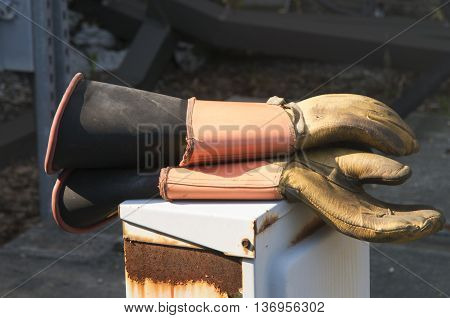 A pair of insulated gloves stands ready to wear to prevent electric shock to a worker