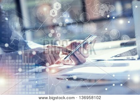 Man Use Smartphone Hand, touch screen.Project Manager Researching Process.Business Team Work Startup modern Office.Global Strategy Virtual Icon.Innovation Graphs Interface.Analyze market stock.Blurred