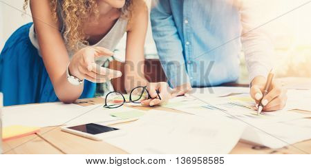 Coworkers Team Work Process Modern Office Loft.Account Managers Produce Creative Idea Project.Young Business Crew Working Startup.Smartphone Wood Table.Analyze Market Reports.Blurred, Film, Flare Effect